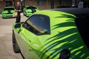 Three green cars